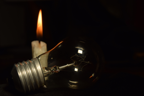 A,Lamp,And,One,Candle,Blur,Burning,In,The,Dark
